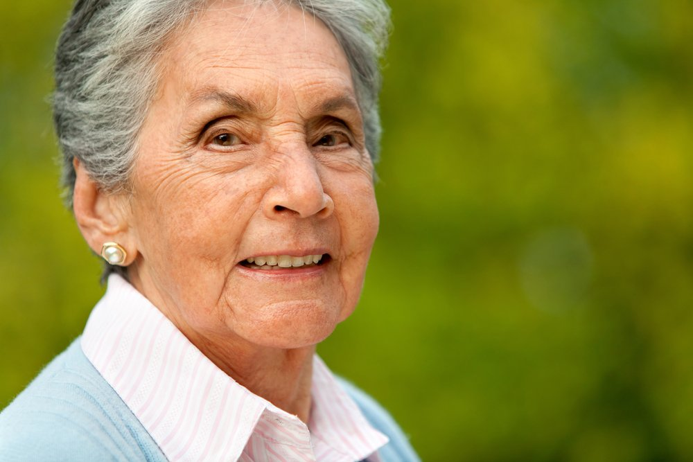 Portrait of a lovely elder woman smiling outdoors